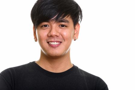 Photo pour Studio shot of cool happy Asian man smiling - image libre de droit