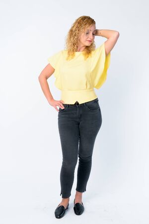 Photo pour Full body shot of beautiful woman with curly blond hair - image libre de droit