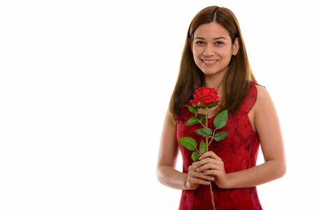 Photo for Studio shot of happy young beautiful woman smiling and holding r - Royalty Free Image
