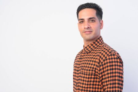 Photo for Closeup profile view of handsome Persian hipster man looking at camera - Royalty Free Image