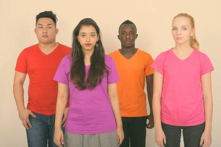 Photo pour Studio shot of diverse group of multi ethnic friends standing together - image libre de droit