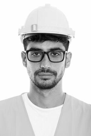 Photo pour Face of young Persian man construction worker wearing eyeglasses - image libre de droit
