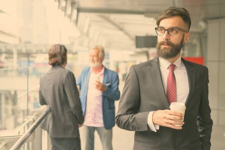 Photo pour Three multi ethnic bearded businessmen together around the city - image libre de droit