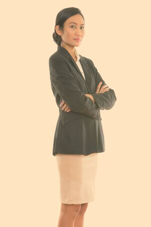 Photo for Studio shot of young Asian businesswoman standing with arms crossed - Royalty Free Image