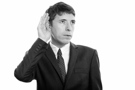 Photo for Portrait of businessman in suit thinking while listening - Royalty Free Image