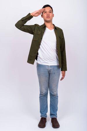Foto per Full body shot of young Asian man wearing jacket - Immagine Royalty Free