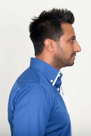 Photo pour Closeup profile view of bearded Indian businessman - image libre de droit