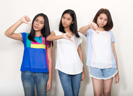 Photo for Portrait of three young beautiful Asian teenage girls as friends together - Royalty Free Image
