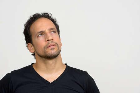 Photo pour Portrait of handsome bearded Hispanic man with curly hair - image libre de droit
