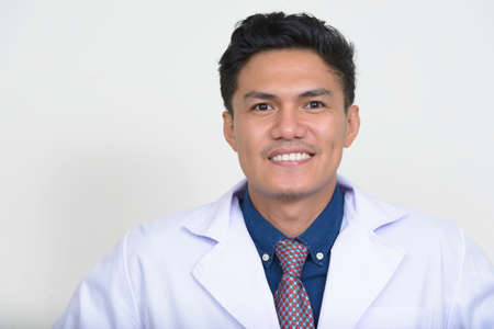 Photo for Portrait of happy handsome Asian man doctor smiling - Royalty Free Image