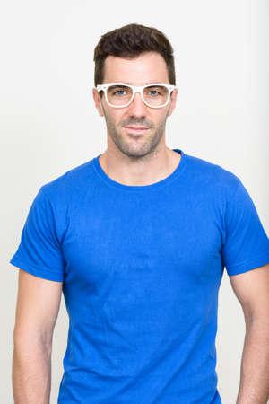 Photo pour Portrait of handsome Hispanic man with beard stubble - image libre de droit
