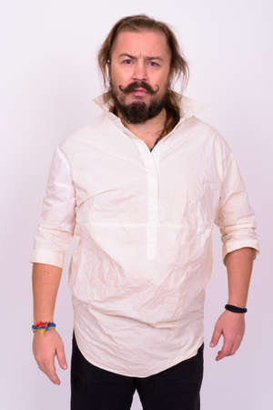 Photo pour Bearded man with mustache and long hair against white background - image libre de droit