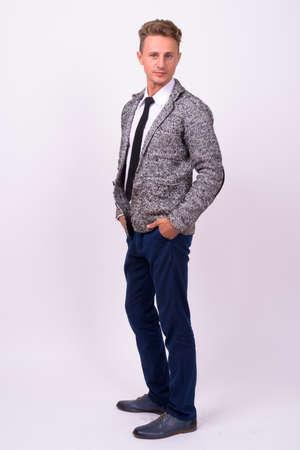Photo pour Handsome businessman with blond curly hair against white background - image libre de droit