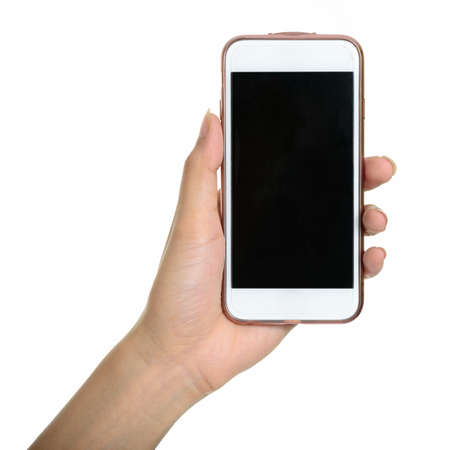 Photo for Portrait of hand holding smart phone against white background - Royalty Free Image