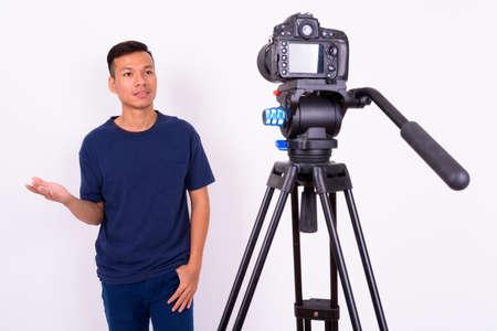 Photo pour Portrait of young Asian man with camera - image libre de droit