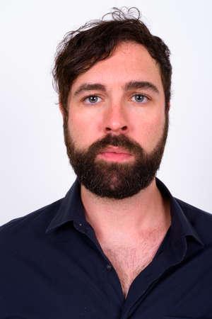 Photo pour Portrait of handsome bearded businessman against white background - image libre de droit