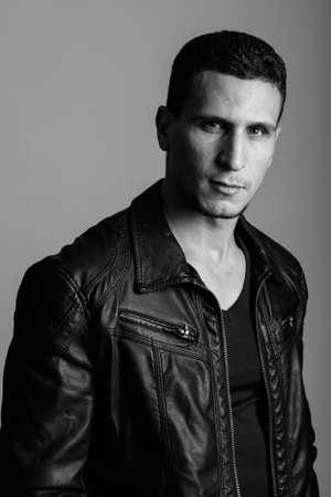 Photo pour Studio shot of young muscular Persian man against gray background - image libre de droit