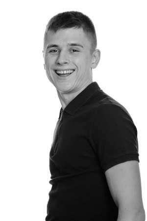 Photo pour Profile view of happy young handsome man smiling - image libre de droit