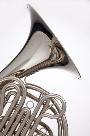 Photo pour A professional silver French horn isolated against a white background in the vertical format. - image libre de droit