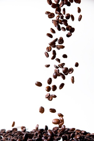 tasty coffee beans dropping down