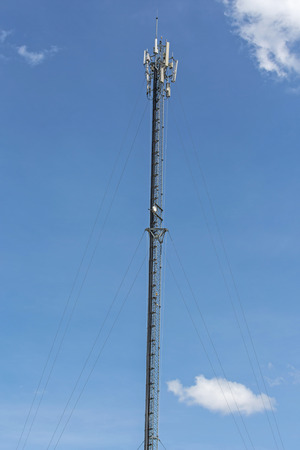 Thai mobile communication tower and sunny day in chiang mai, thailand