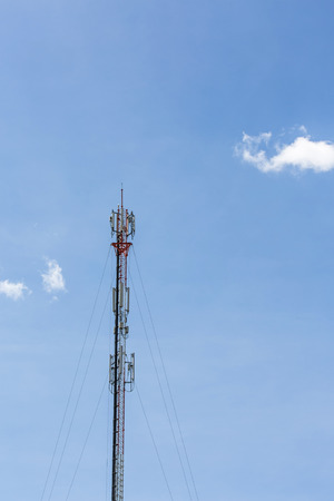 The mobile communication tower and sunny day in north of thailand