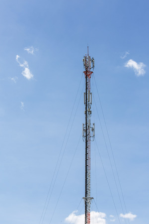 High mobile communication tower and sunny day in sunny day from thailand