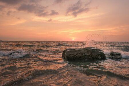 Photo for Seawaves hitting rocks on beach during sunset. - Royalty Free Image