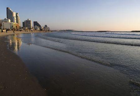 Sunset over the Mediterranean, along the beach at Tel Aviv, Israel.