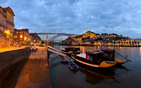 panorama old Porto river Duoro, vintage port transporting boats, old town, town of Gaia and famous bridge Ponte dom Luis, Portugal