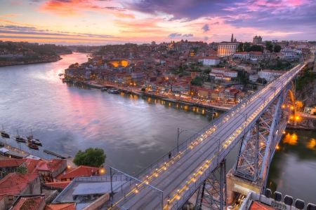 Photo for Lighted  famous bridge Ponte dom Luis above  Old town Porto at river Duoro at night, Portugal   - Royalty Free Image