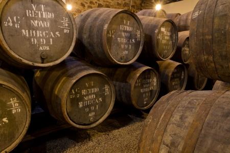 wooden barrels hold Port fortified wine to mature in wine cellars in Villa Nova de Gaia, Portugal