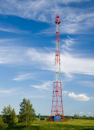 GSM cell transmission station and summer landscape with cloudy sky