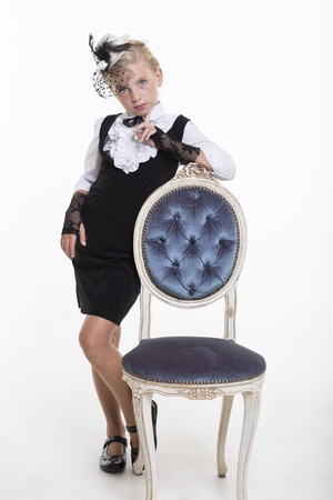 Beautiful girl with old chair