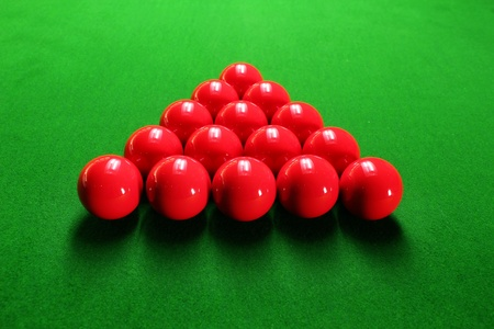 Snooker balls arranged in triangular shape ready for play