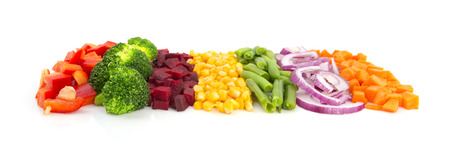 Colorful cut vegetables in a line with perspective isolated on white backgroundの写真素材