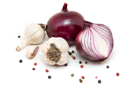 Garlic, red onions and peppercorn isolated on white background