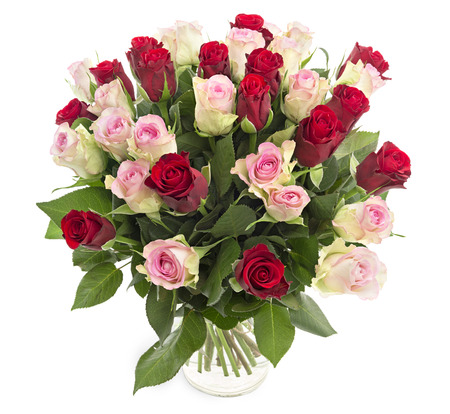 Photo pour Beautiful fresh red and pink roses in a vase isolated on white background - image libre de droit