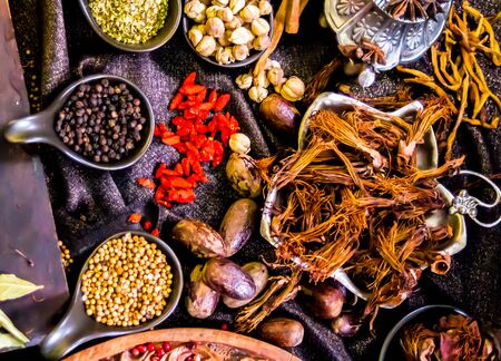 Photo for Top view Thai spices and herbs ingredient decoration on wood table for cook in home kitchen. - Royalty Free Image