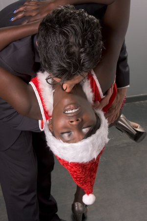 Seductive ethnic black African-American woman prostitute working with client, middle aged businessman in business suit