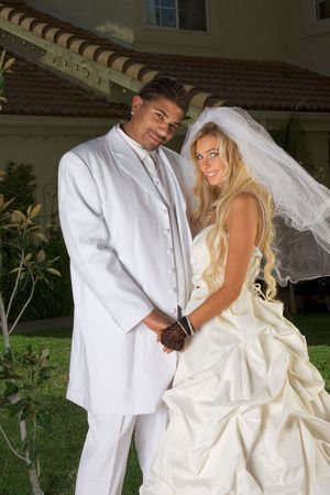 Interracial couple outdoors. Smiling laughing newlywed young ...