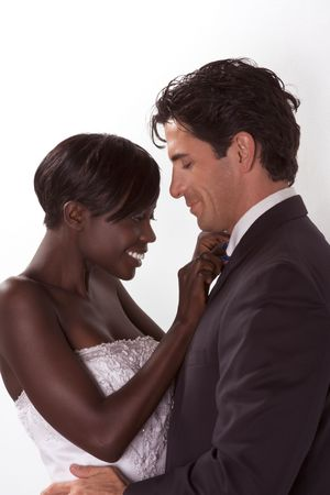 romantic newlywed young ethnic black African American woman and mid aged Caucasian man