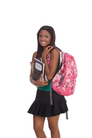 education series - Friendly ethnic black female high school student with backpack and composition bookの写真素材