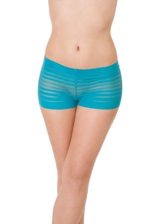 Young Caucasian woman modeling blue lingerie