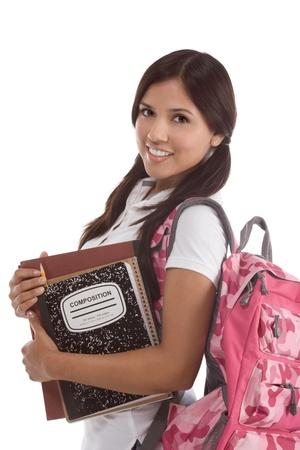 Foto de education series - Friendly ethnic Latina female high school student with backpack and composition book - Imagen libre de derechos