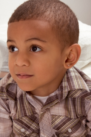 Portrait of ethnic Young little boy in checkered shirt