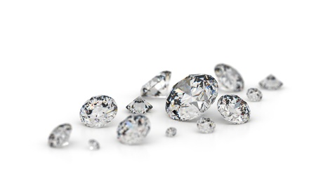 Several diamonds on a white background. Focus on the largest stone.