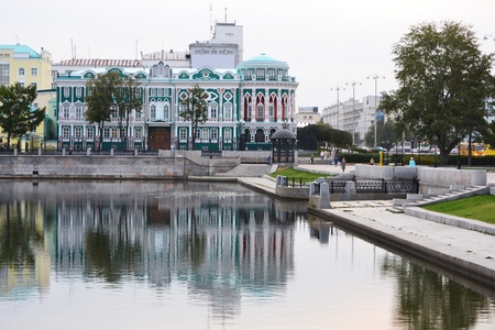 Beautiful historical building at the bank of city pond in Yekaterinburg, Russia