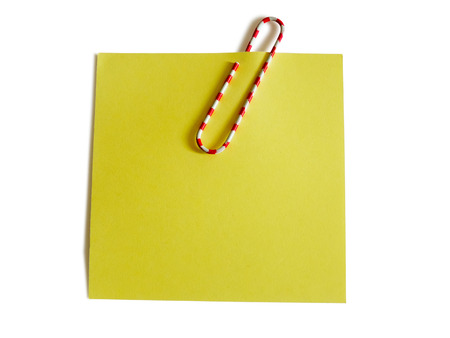 Yellow note with color paper clip isolated on white background
