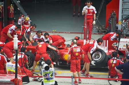 Sepang F1 Circuit, Malaysia - April 2, 2010 - The crew of Scuderia Ferrari Marlboro F1 racing team practicing tyres change during Petronas Malaysian Grand Prix 2010 April 2-4, Sepang.